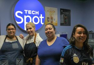Tech Spot employees at the new cafe.
