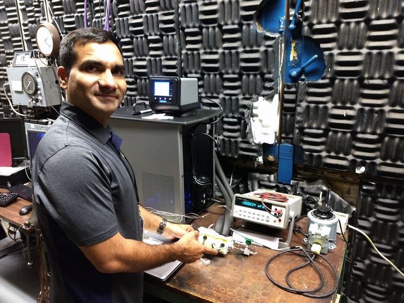 Dr. Yogendra Panta displays a prototype device in a laboratory at the NASA Glenn Research Center in Cleveland, Ohio.
