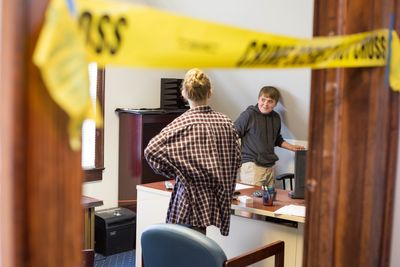 Forensic Camp student Jed White works to investigate a crime scene.