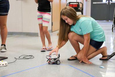 Students in the GIRLS program put their programming skills to the test with LEGO robots.