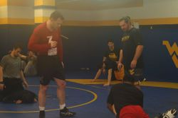 Taylor works with WVU Tech wrestlers during his visit.