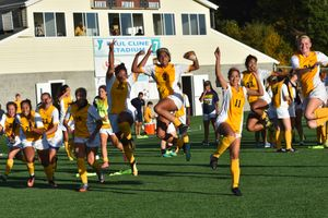 Women's soccer celebrates a Homecoming win.