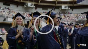 An image of a video player with three WVU Tech grads, one of them showing the camera the peace sign.