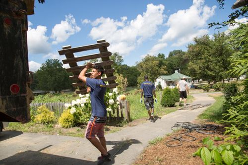 A WVU Tech student helps clean up during flood relief efforts
