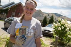 A WVU Tech student shares a find during flood relief cleanup efforts