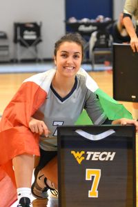 Carolina Bologna receives her senior gift for Volleyball