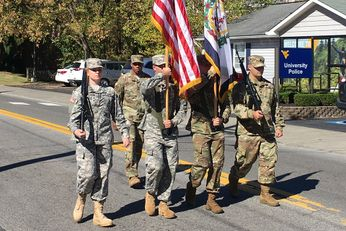 Army ROTC students march in a parade