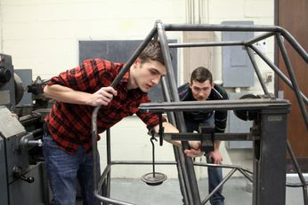 Baja SAEstudents work on a vechicle frame