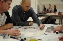 Landscape architect and alumnus Rob Dinsmore works with students during the 2016 charrette.