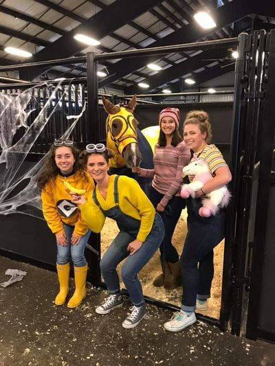 Dressed as Minons, members of WU Collegiate Horsement's Association pose with Marty during the 2018 Halloween with the Horses event