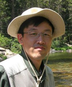 headshot of Dr. Park standing in river