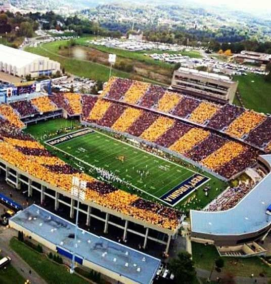aerial image of Mountaineer Stadium striped in gold and blue