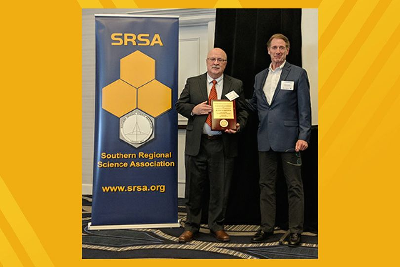Peter Schaeffer accepts SRSA Fellow plaque during the 2018 annual conference in Philadelphia.