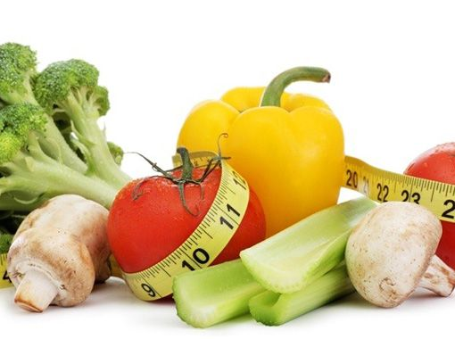 Fruits and vegetables surrounded by tape measure