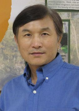 headshot of Jinyang Deng