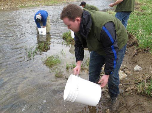 student sampling water