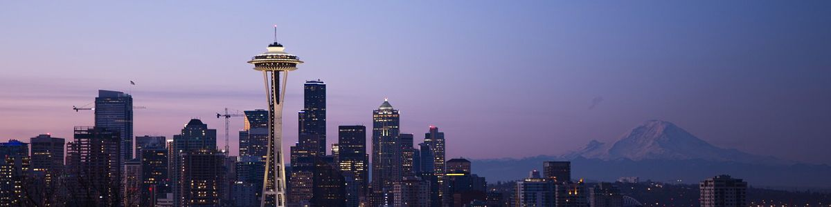 Seattle city skyline with Mount Rainer in the background just after sunset.