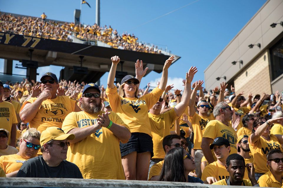 WVU Fans cheering from the stands at a WVU Gold Rush game