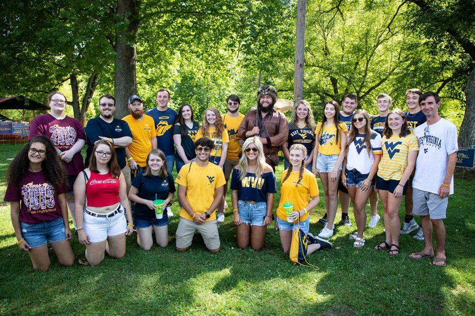 WVU Alumni Boone County chapter scholarship recipients posing with the Mountaineer
