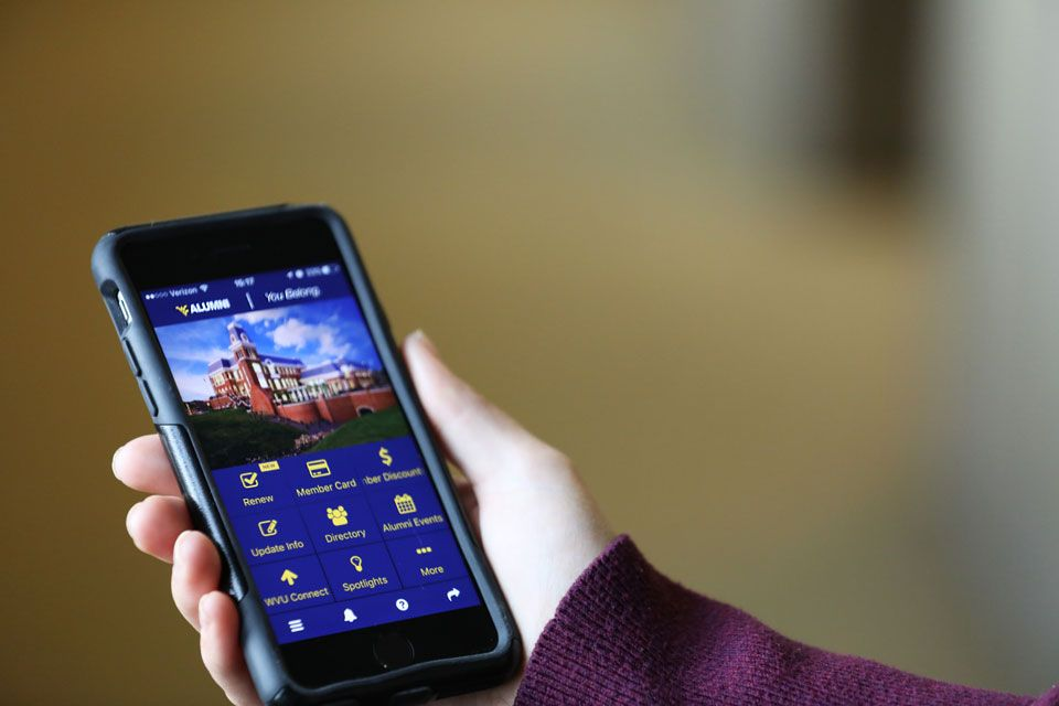 wvu alumni association mobile application on a phone