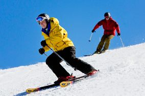 Skiers on the slopes at Winterplace