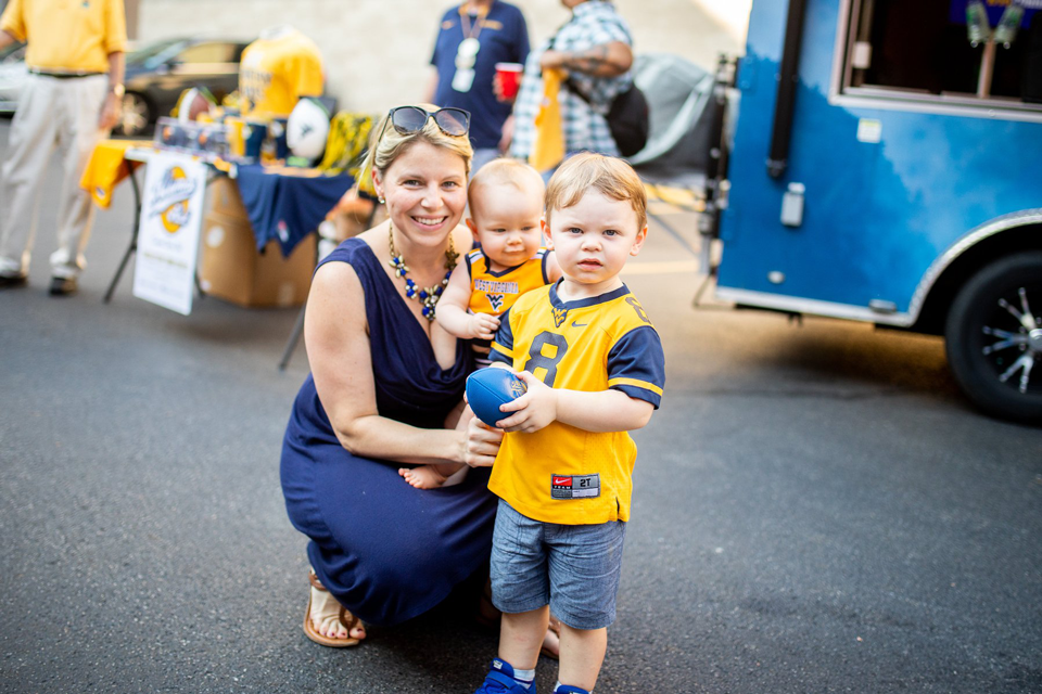 A mother and her two kids enjoying a WVU Chapter event
