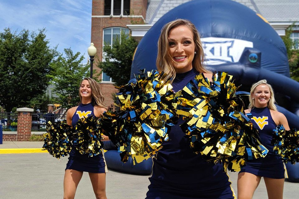 The WVU dance team in front of the Erickson Alumni Center