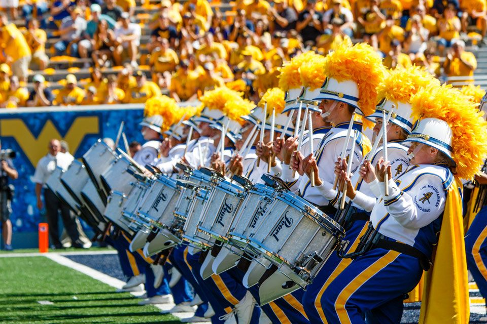 WVU Pride Drumline playing on the field
