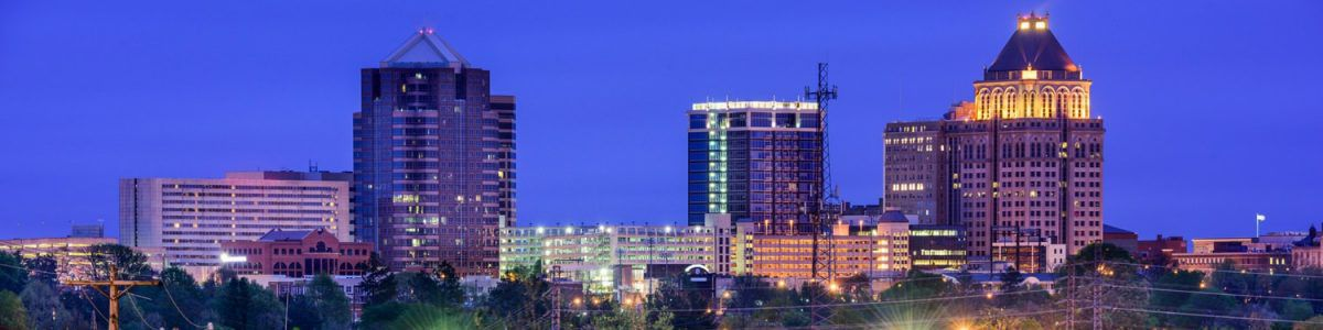 The Greensboro city skyline at night.