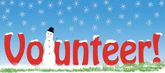 "Volunteer with a snowman taking the place of the ""L.""  Snow falling in the background."