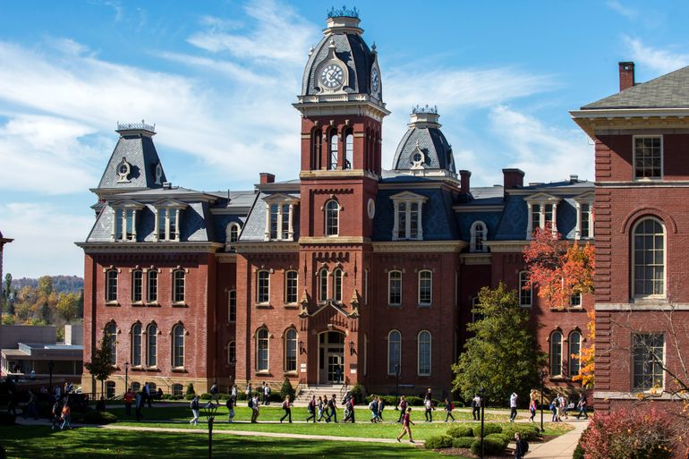 Woodburn Hall on WVU's downtown campus with groups of students walking in front of it.