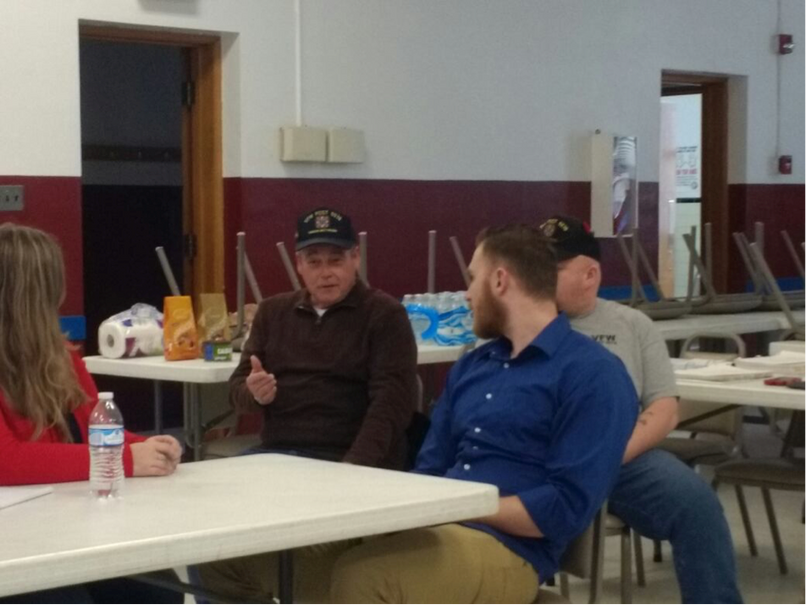 Veterans Advocate Alex Jonese (blue shirt) provides reassurance to a veteran of VFW Post 5578 during the Veterans Advocacy Clinic's recent trip to Madison, West Virginia.