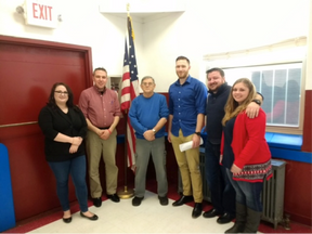 Veterans Advocacy Clinic Students (from left) Rachel Roush, Brad DeFlumeri, Alex Jonese, C.J. Reid, and Kirsten Lilly pose with United States Marine Corps Veteran Joe Gero (third from left), of Madison, during the students' visit to VFW Post 5578.