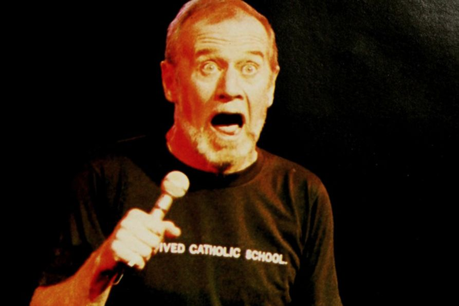George Carlin on stage at the Coliseum
