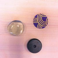 Black magnet, clear cover and paper with purple and gold pattern for making patterned magnets