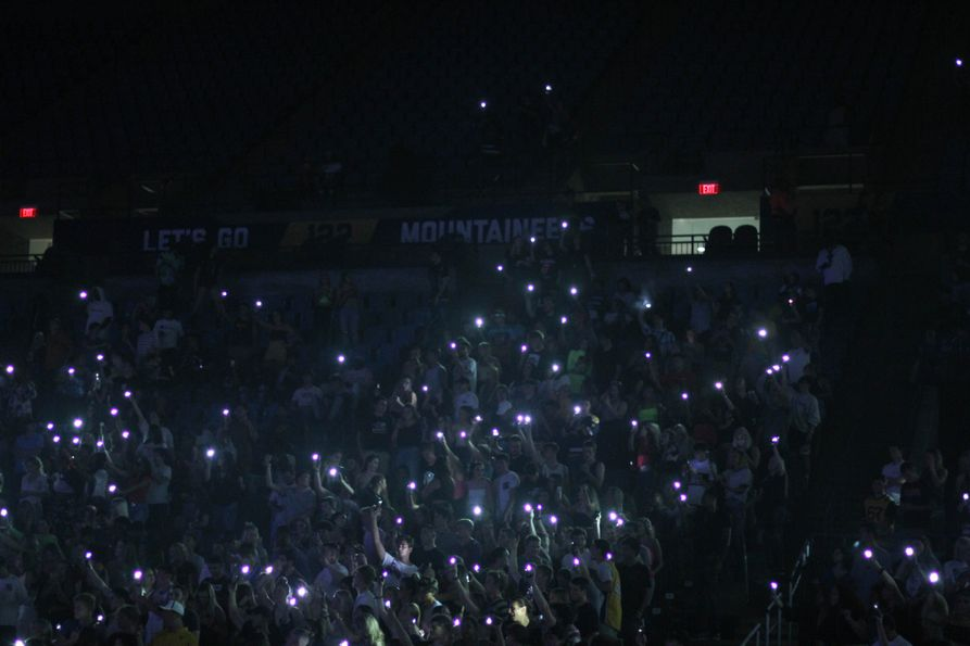 The Coliseum crowd holding up their cellphone flashlights in 2019