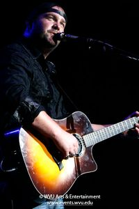 Lee Brice playing guitar in 2010.