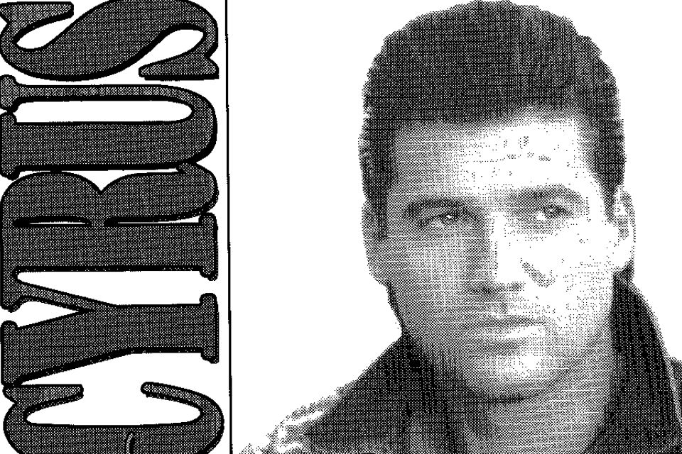 "Black and white photo of Billy Ray Cyrus from 1994 with the text ""Cyrus"""