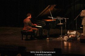 A member of His International All Stars performing on stage at the WVU Creative Arts Center. Photo by Logan McMasters.