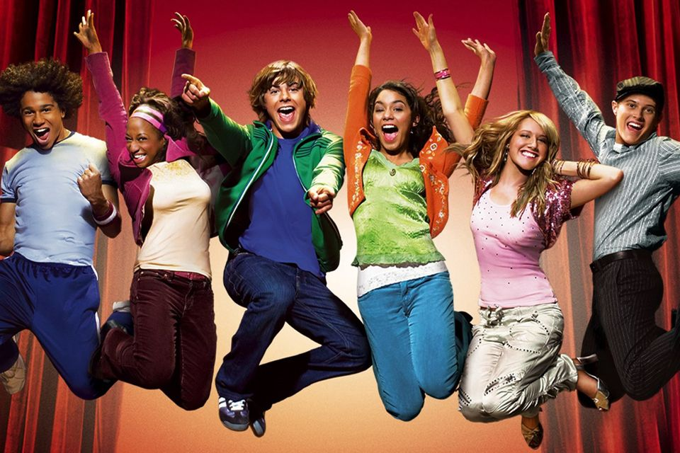 The cast of High School Musical leaping in the air.