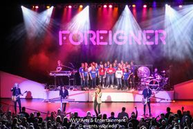 The Morgantown High School Choir and Foreigner performing at the WVU Creative Arts Center.