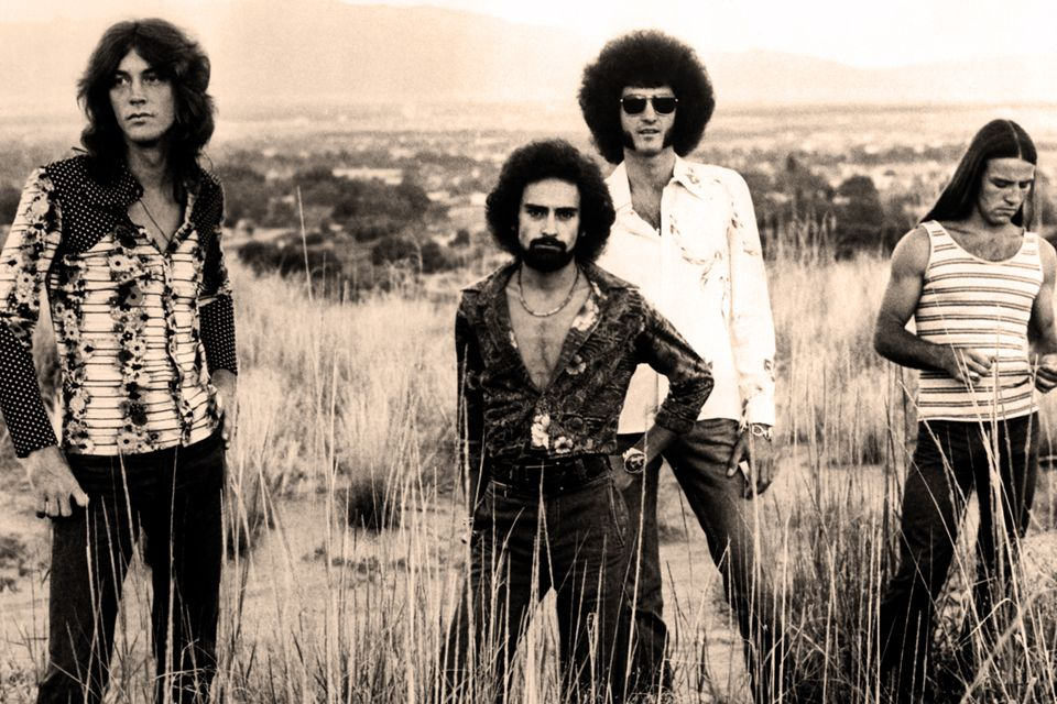a publicity photo of the members of Grand Funk Railroad