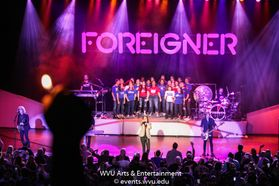 Foreigner and the Morgantown High School Choir performing at the WVU Creative Arts Center.