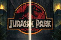 Jurassic Park film post with jeep pointing headlight at the gates of the park