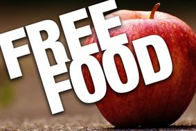 "Brown background with a red apple. Text reads ""Free Food."""
