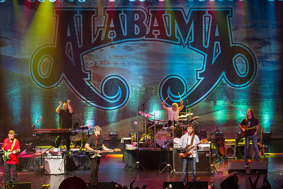 Colorful photo of Alabama performing on stage.