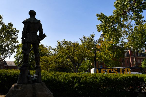 silhouette of a statue against bright blue sky