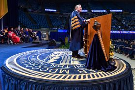 WVU President E. Gordon Gee stands at the Commencement podium