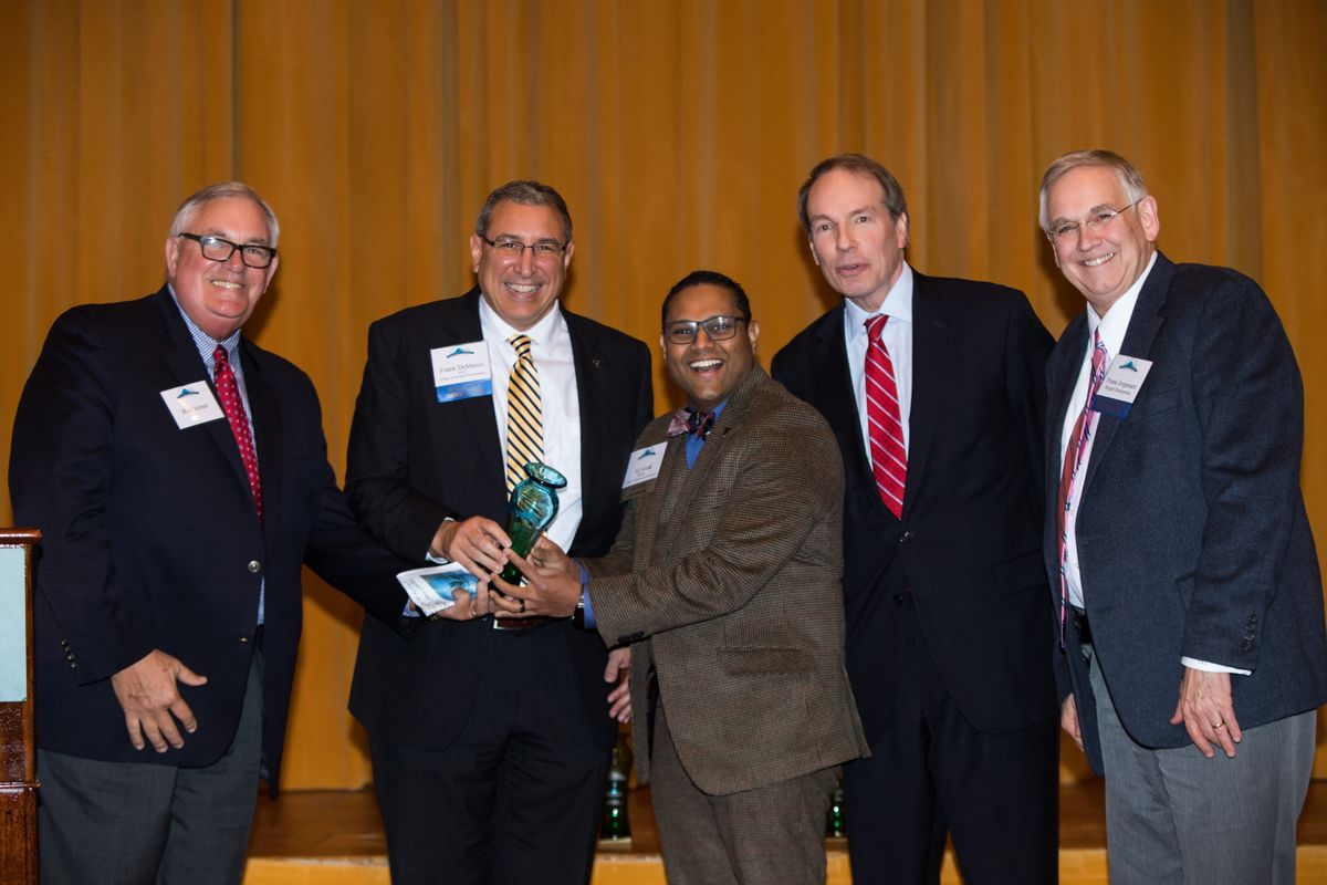 Rod Stoner, retired hotel executive; Frank DeMarco and Dr. Ajay Aluri, who head the program at the WVU College of Business and Economics; Tom Heywood, master of ceremonies for the awards event; and Frank Jorgensen, WVHTA chairman at the 8th Annual Hospitality University conference.