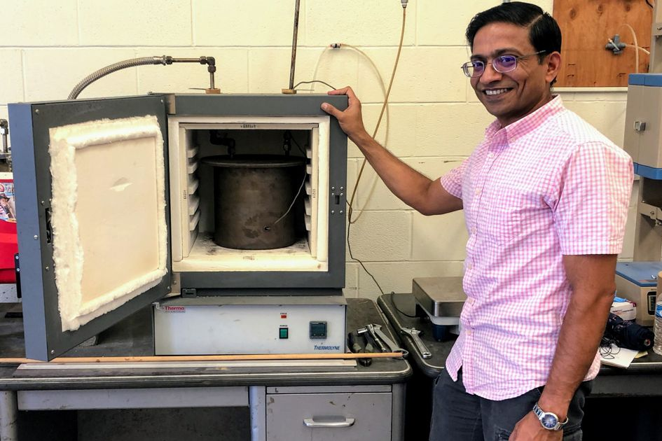 Kaushlendra Singh with instrument that creates biochar